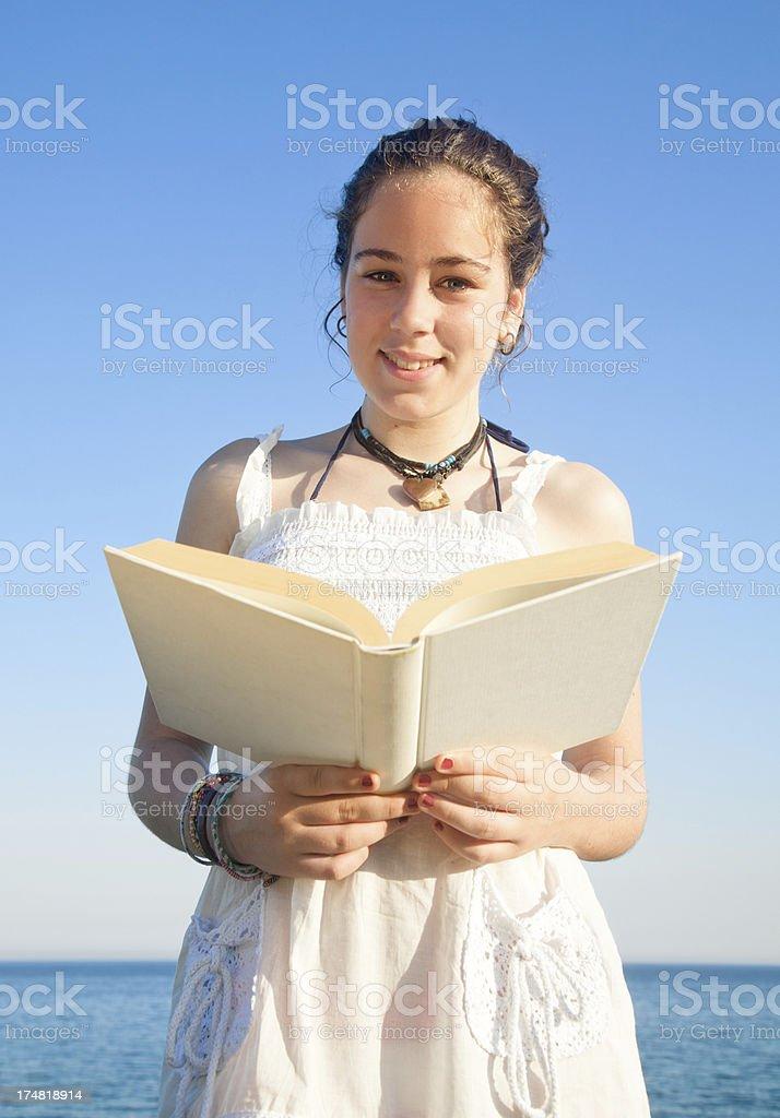 Teen reading outdoors royalty-free stock photo