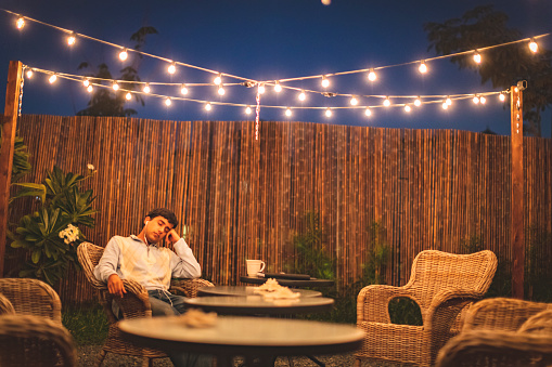 Patio, Relaxation, Young Adult - Teen listening to music and relaxing at the backyard