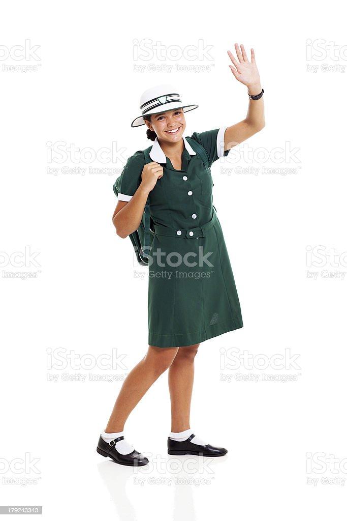 teen schoolgirl waving her hand royalty-free stock photo