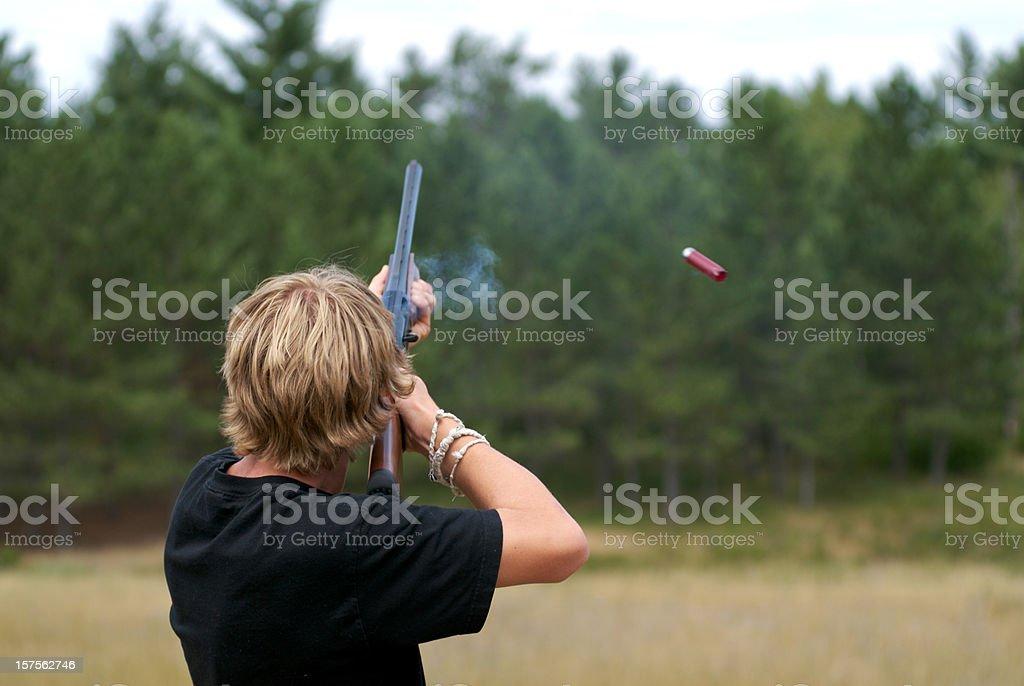 Teen shooting a gun stock photo