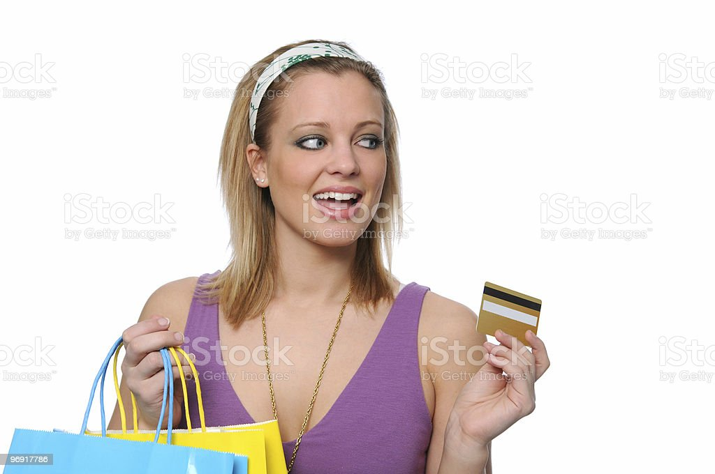 Teen shopping and paying with a credit card royalty-free stock photo