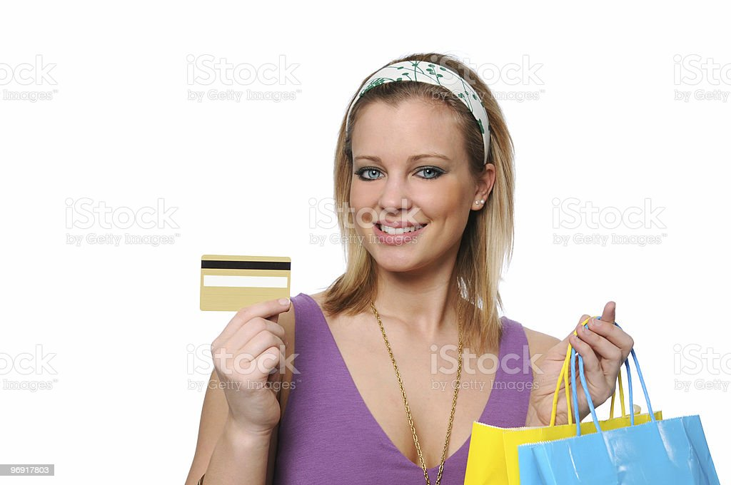 Teen shopping showing a credit card royalty-free stock photo