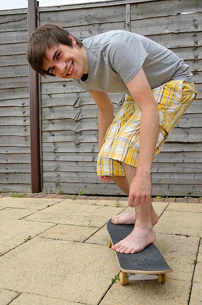 bare feet of male teens