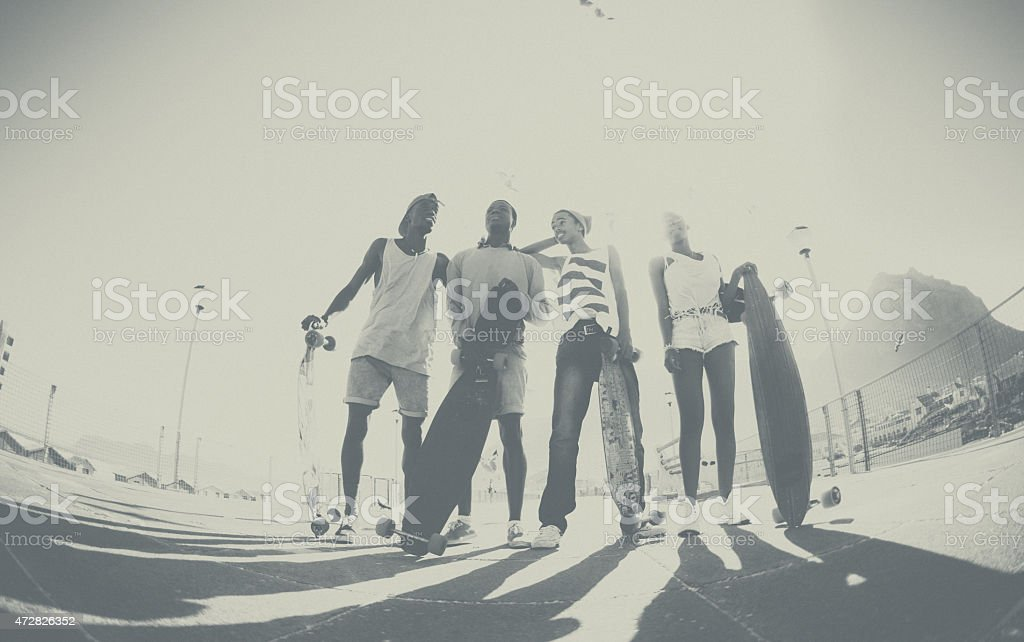 Teen skater friends standing together looking cool stock photo