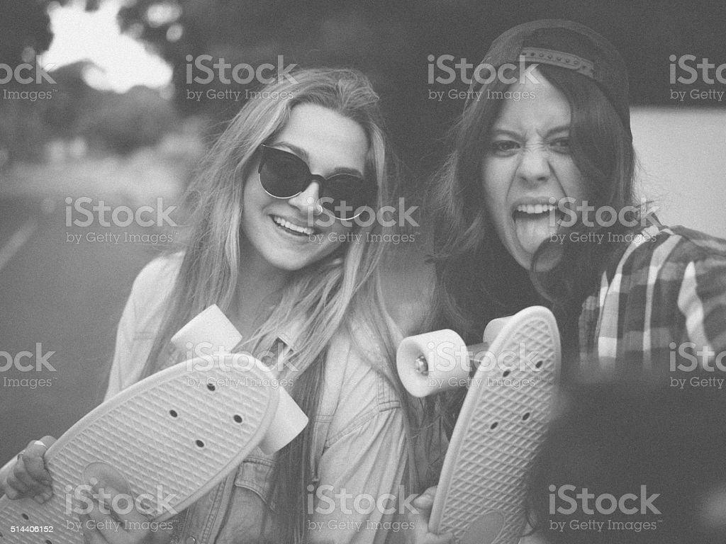 Teen skater girls taking a crazy self portrait together stok fotoğrafı