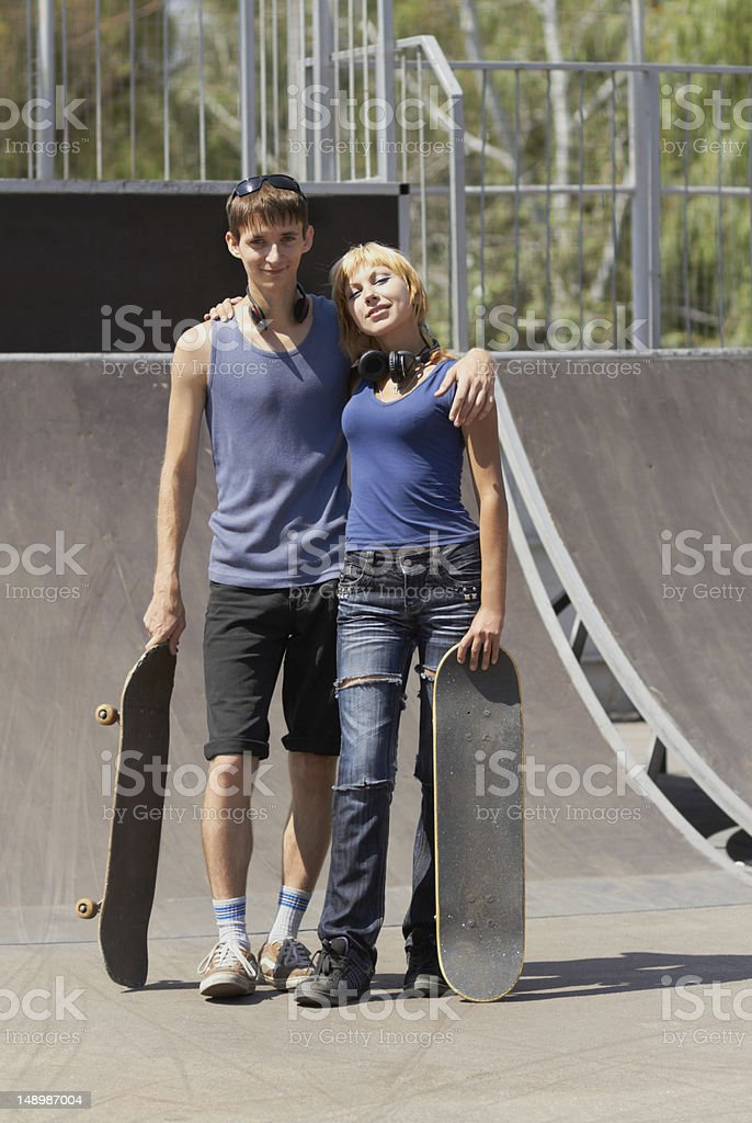 Teen skaters with boards in skatepark royalty-free stock photo