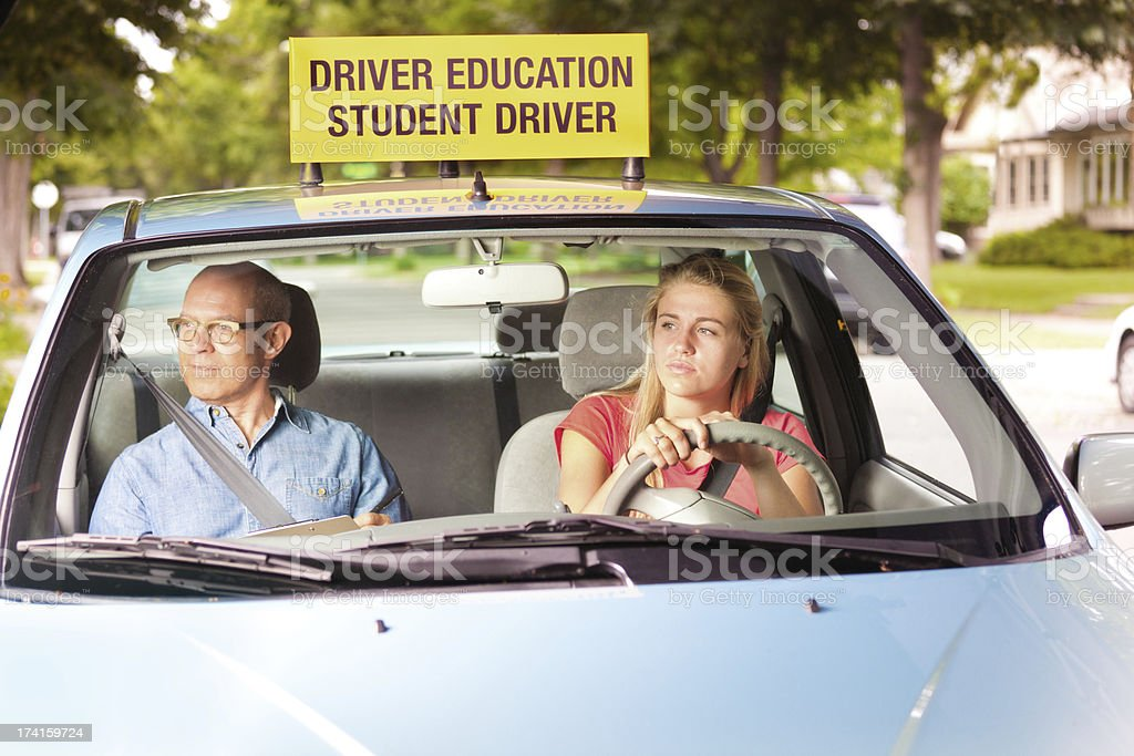 Teen Student Driver Learning to Drive with Driving Instructor stock photo