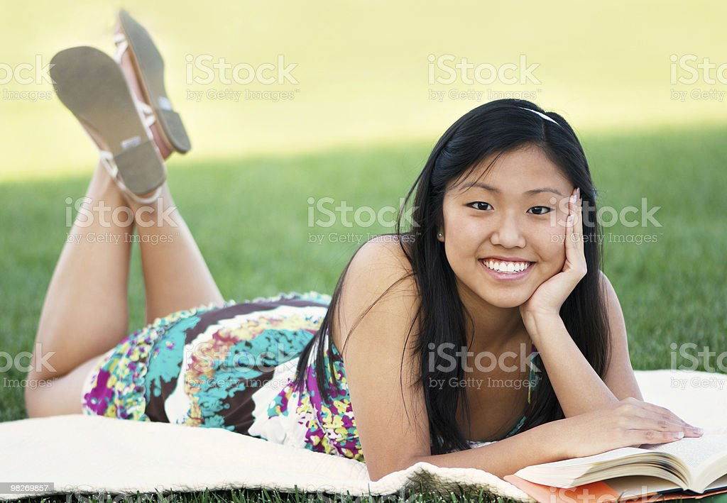 Teen Student Reading At The Park royalty-free stock photo