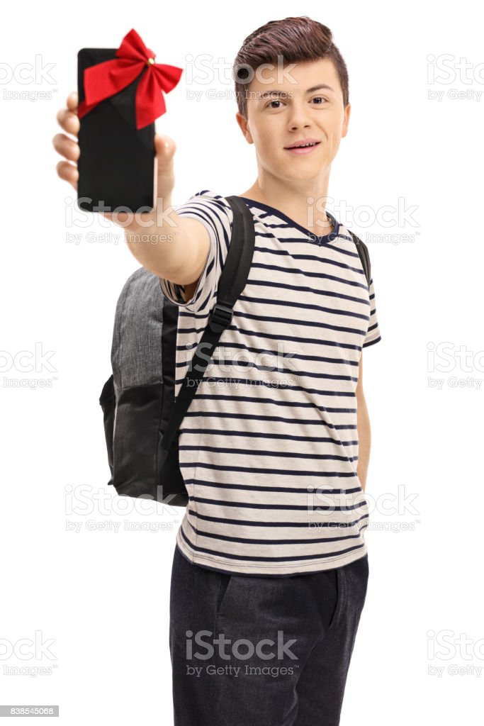 Teen student showing phone wrapped with red ribbon as present stock photo