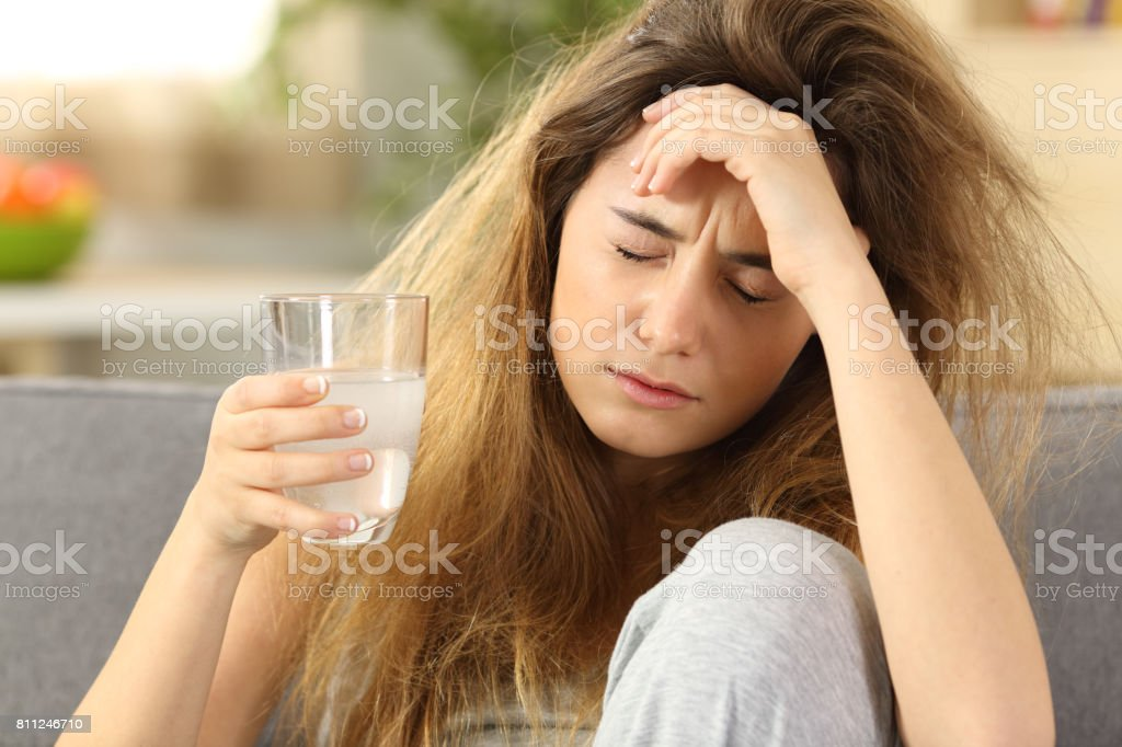 Teen suffering head ache at home stock photo