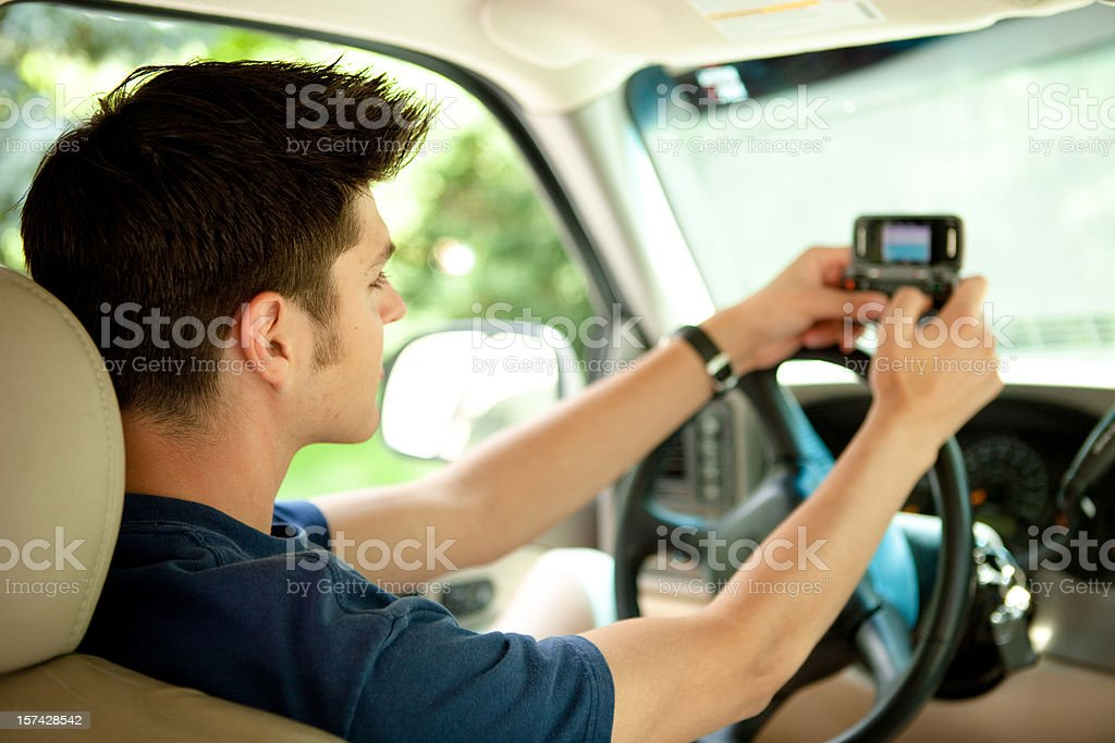 Teen texting while driving royalty-free stock photo