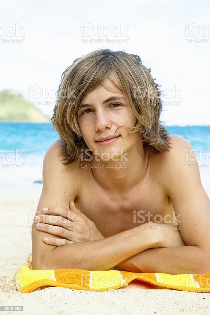 Teen without shirt on at beach royalty-free stock photo