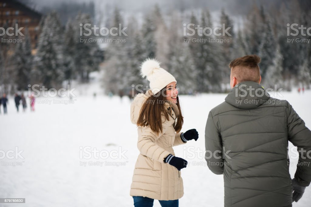 Teen woman being chased by her boyfriend stock photo