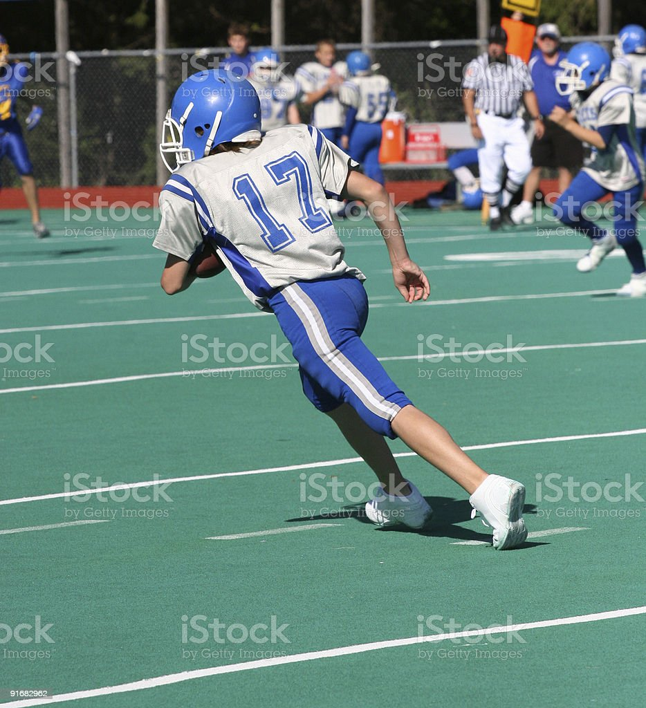 Teen Youth Football Player Running with Ball royalty-free stock photo
