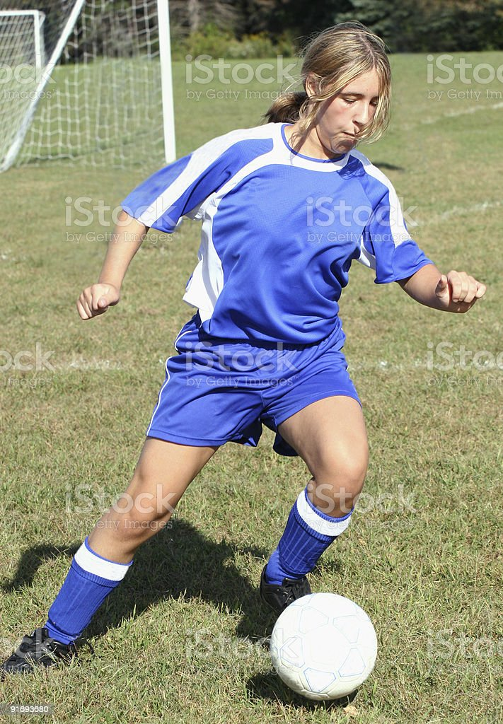 Teen Youth Soccer Player Ready to Kick Ball royalty-free stock photo