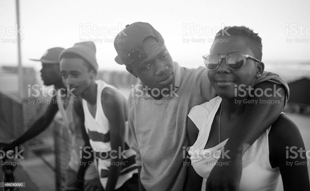 Teenage African American couple with friends stock photo