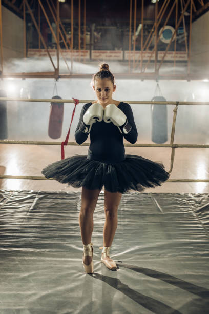 Teenage ballet dancer on a boxing training in a ring. stock photo