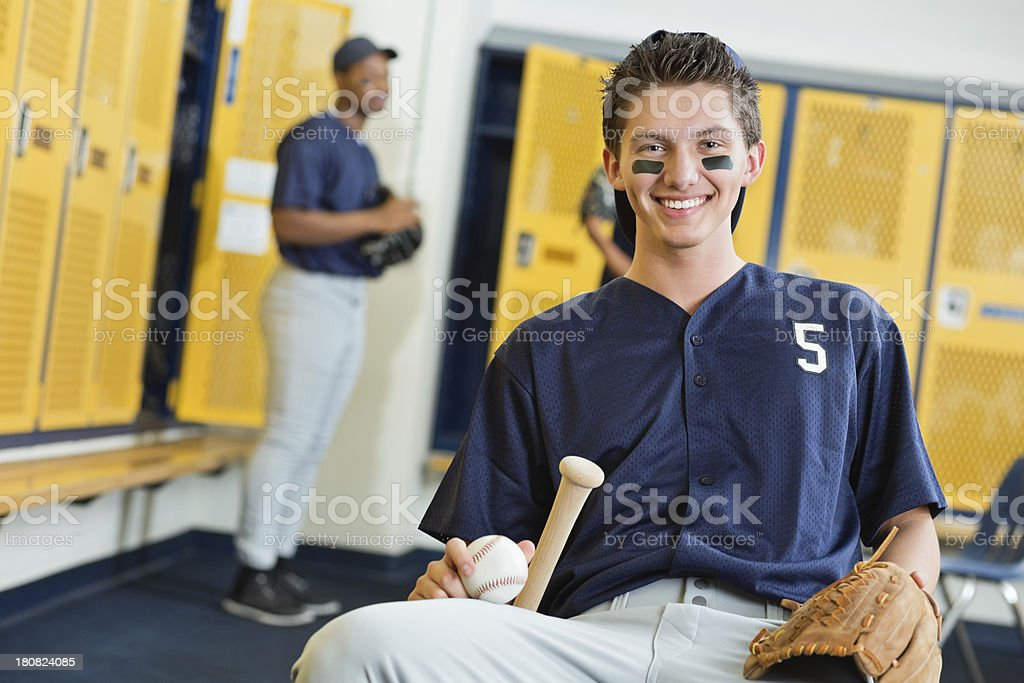 Teenage Baseball Player In High School Locker Room Royalty Free Stock Photo