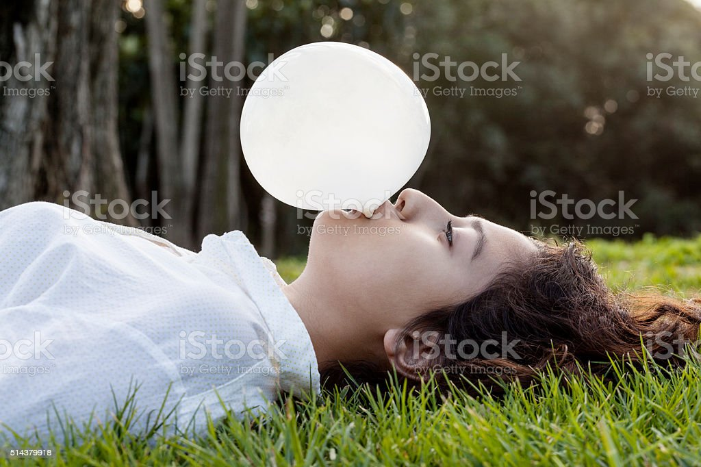 Teenage blowing a bubble stock photo