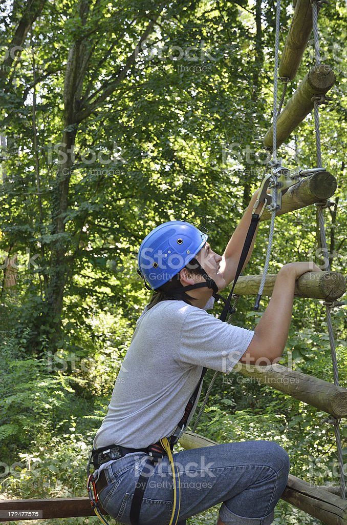 Teenage boy at the ropes course stock photo
