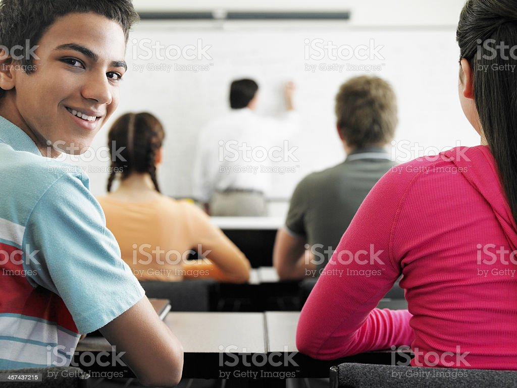 Teenage Boy Attending Lecture In Classroom royalty-free stock photo