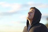 Teenage boy breathing deep fresh air