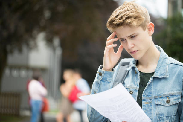 Teenage Boy Disappointed With Exam Results stock photo