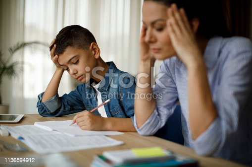 istock Teenage boy having problems in finishing homework 1136594912
