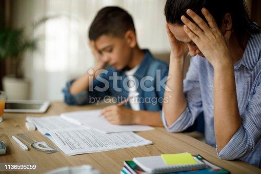 istock Teenage boy having problems in finishing homework 1136595259