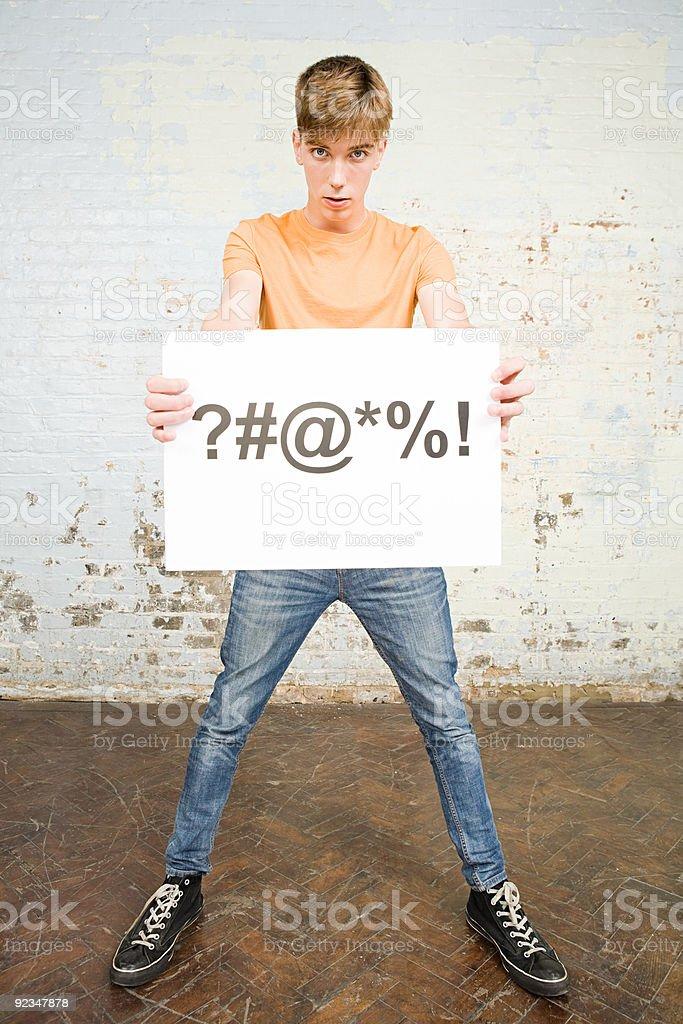 Teenage boy holding sign stock photo