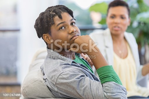 istock Teenage boy ignores lecturing mother at home 1051247488