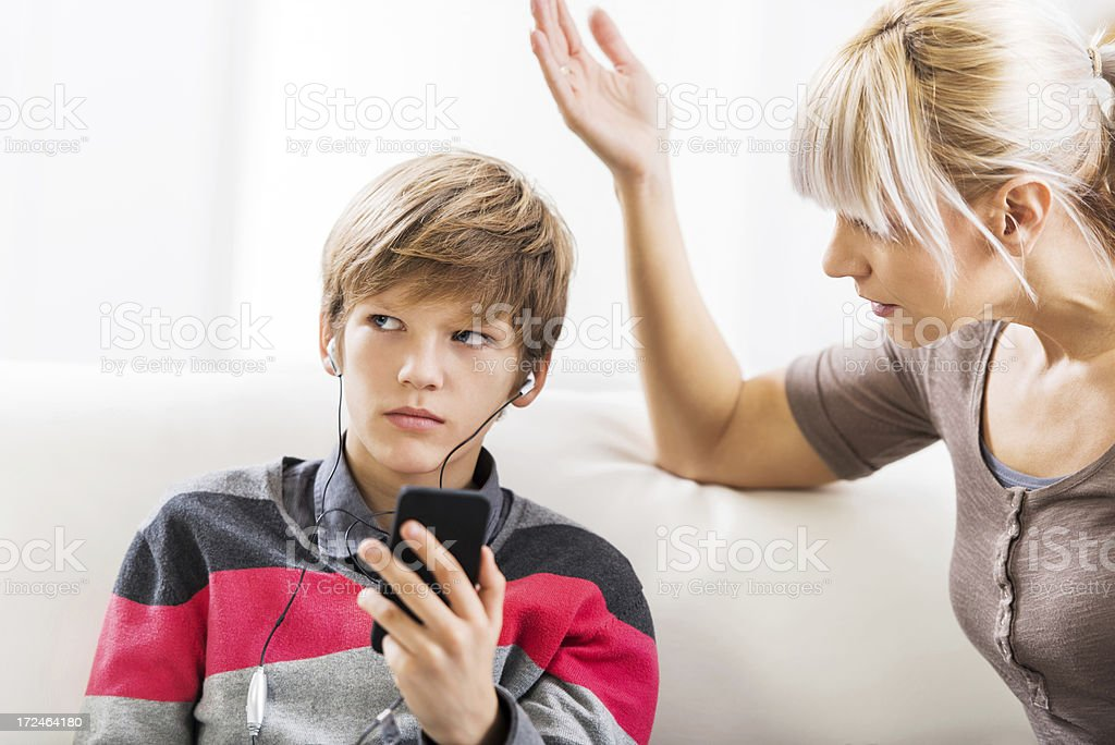 Teenage boy ignoring his mother royalty-free stock photo