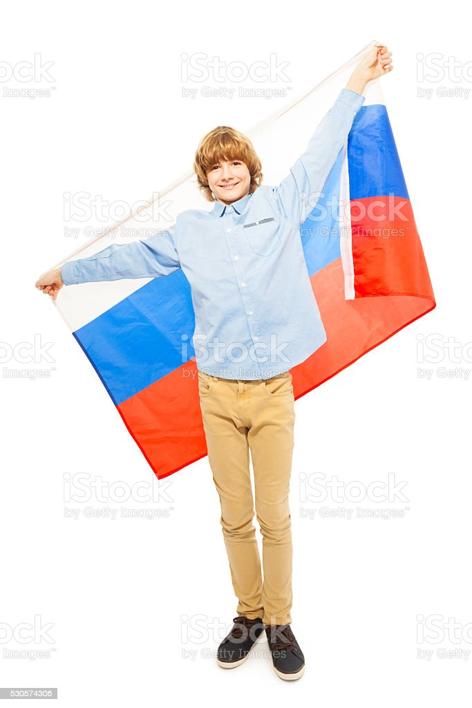 Teenage boy in full height waving Russian flag stock photo