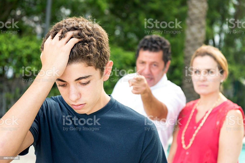 Teenage boy in troubles stock photo