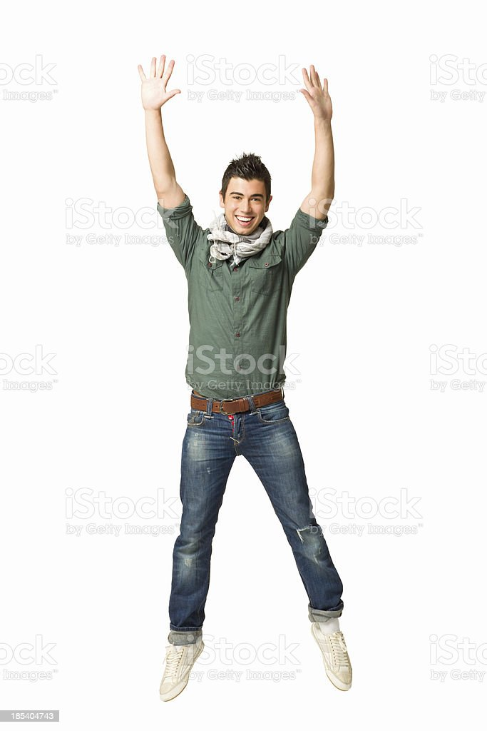 Teenage Boy Jumping in Celebration stock photo