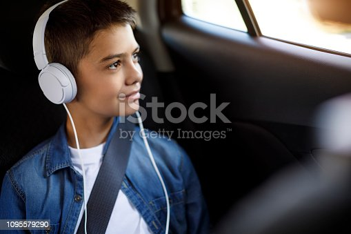 Teenage boy listening to music in the car