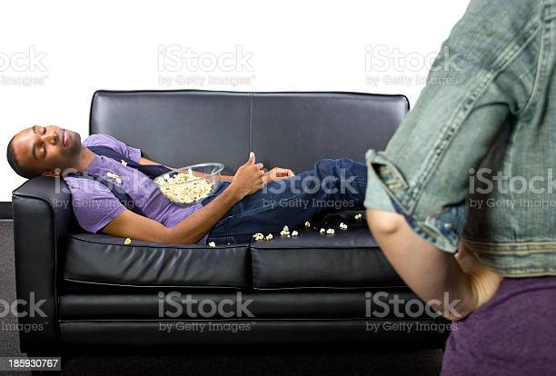 Teenage boy napping on a leather couch spilling popcorn picture id185930767?b=1&k=6&m=185930767&s=612x612&h=p31p go9qcvqkij1opcjttx0lbsgn zzq ofrcsyu1e=