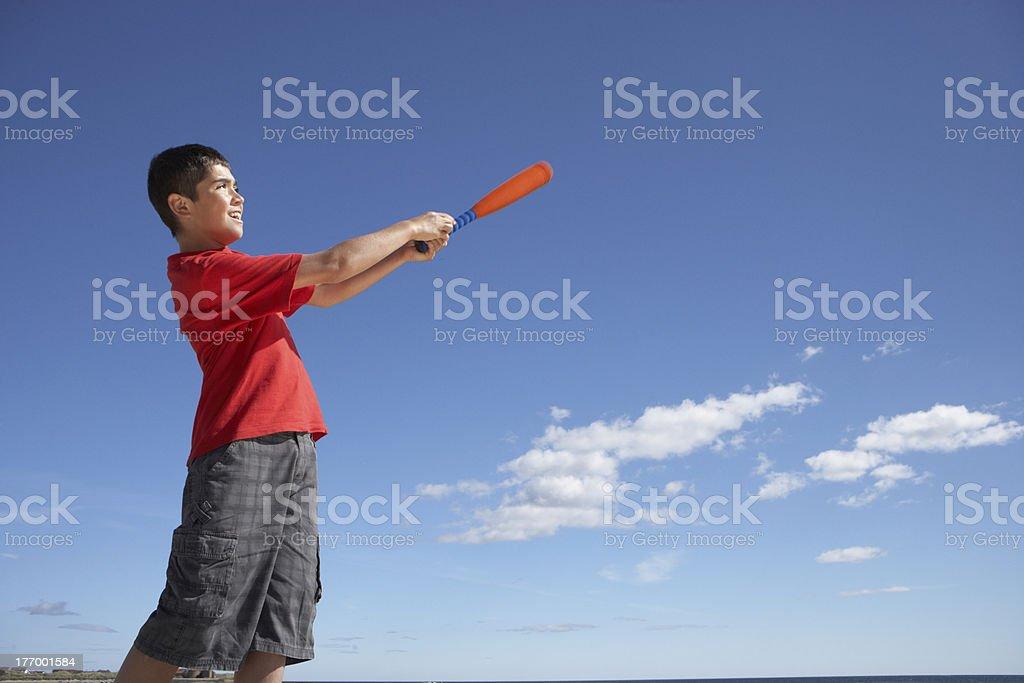 Teenage boy playing baseball stock photo