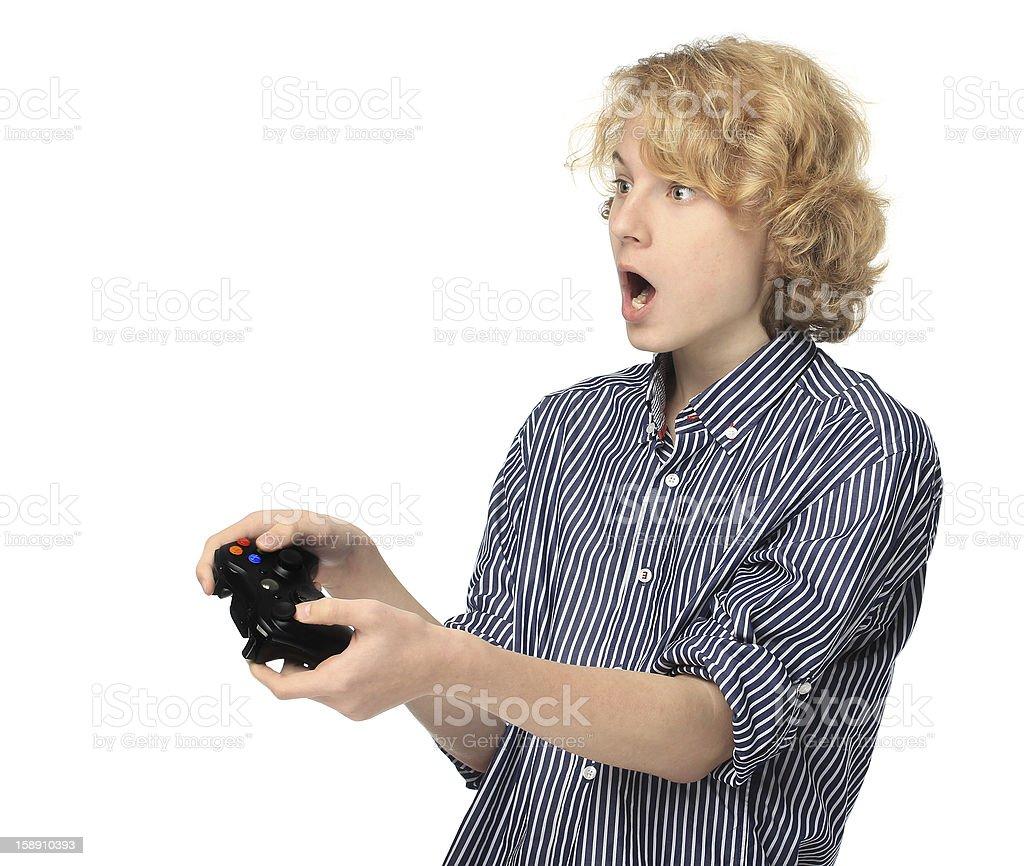 Teenage boy  playing  game.Shocked royalty-free stock photo