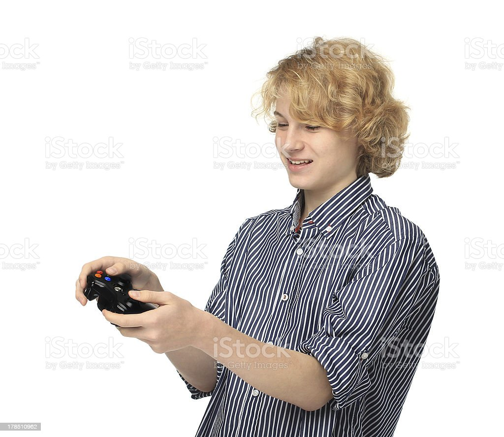 Teenage boy  playing  game.Smiling royalty-free stock photo
