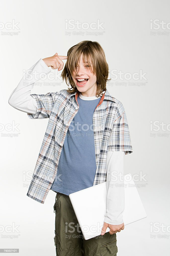 A teenage boy pointing at his head royalty-free 스톡 사진