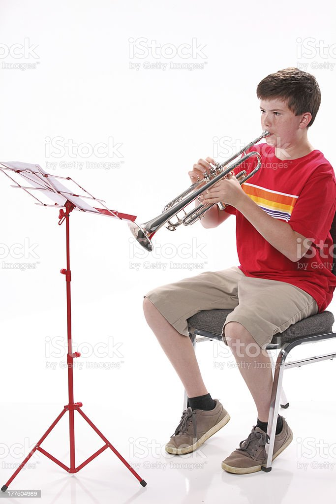 Teenage Boy Practicing Trumpet stock photo