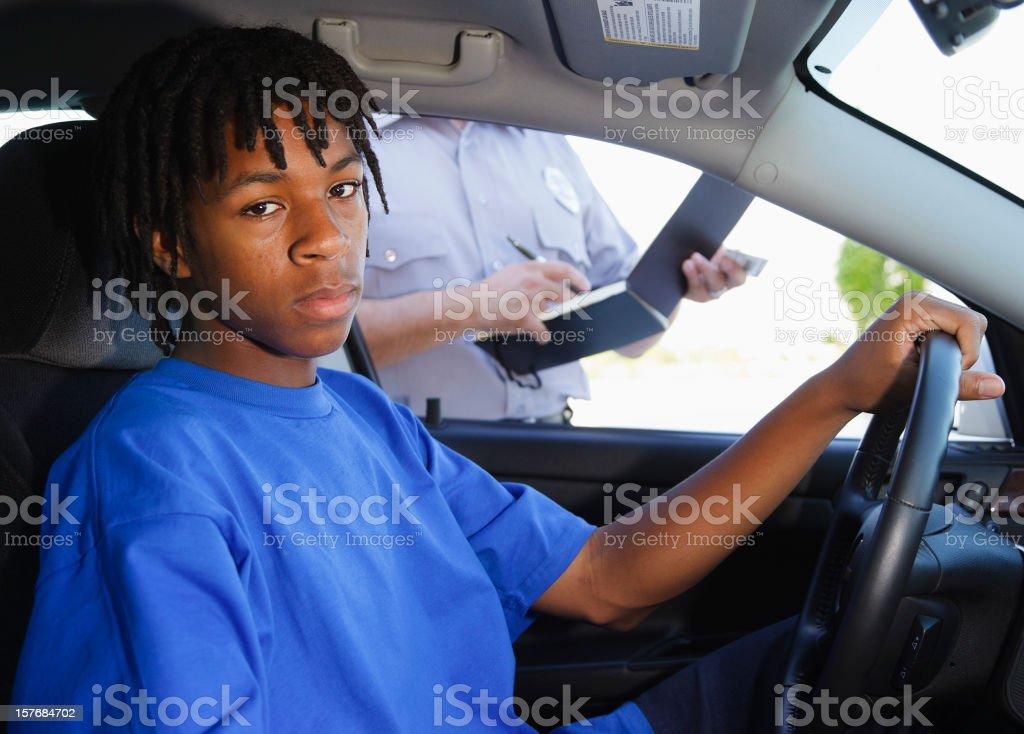 Teenage Boy Receiving a Ticket stock photo