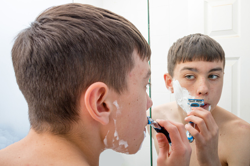 Teenage Boy Shaving In The Morning Stock Photo - Download