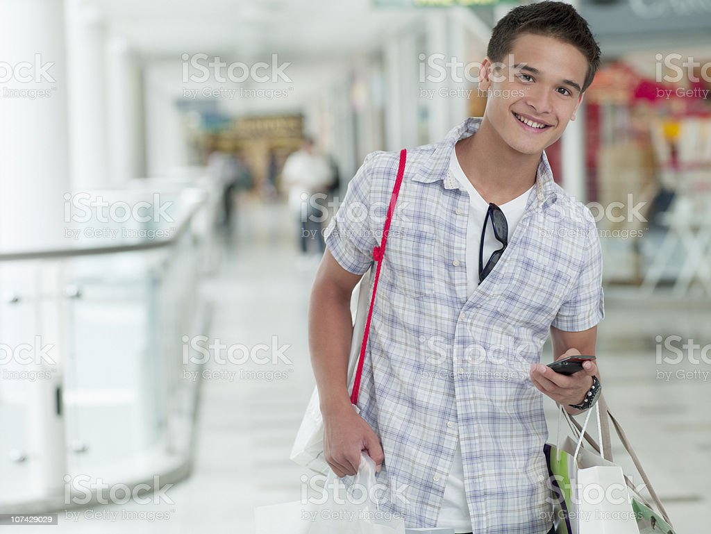 Teenage boy shopping in mall royalty-free stock photo