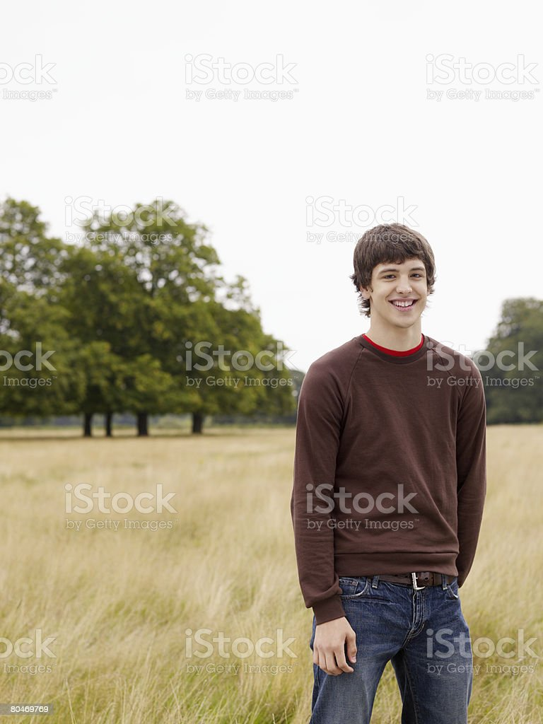 Teenage boy standing in a field royalty-free 스톡 사진