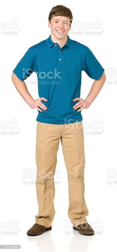 Teenage Boy Standing With Hands On Hips stock photo
