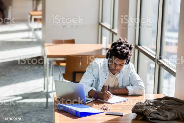 Teenage boy studies in school library picture id1137620178?b=1&k=6&m=1137620178&s=612x612&h=q0o 8rv1apd7tczivryt tkp9navcnz6fv6thm mjfw=