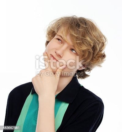 istock Teenage boy thinking about something 483662581