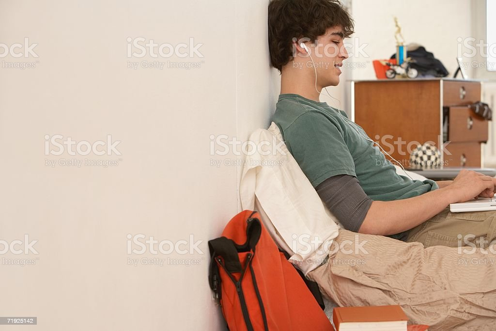 Teenage boy using laptop royalty-free stock photo